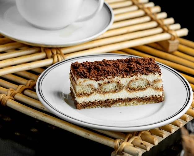 Italian tiramisu dessert plate served on bamboo boards