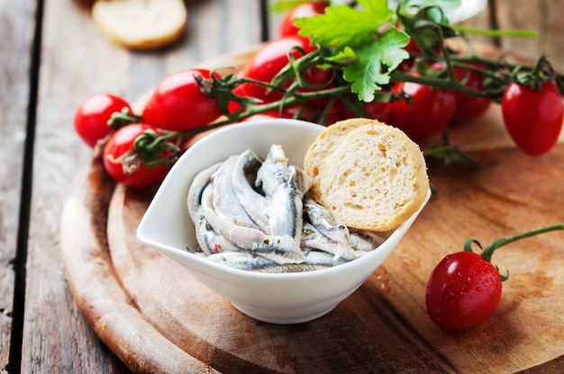 Italian traditional anchovies with bread and tomato