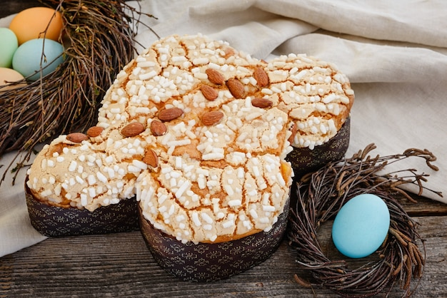 Italian traditional easter cake. colomba in sugar glaze and with almonds.