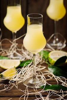Italian traditional liqueur with lemons on the vintage table
