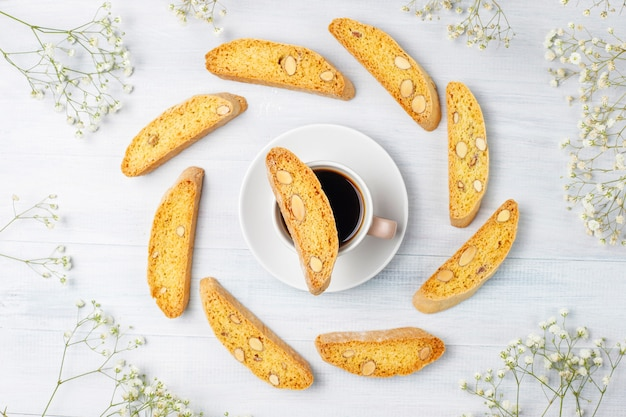 Italian tuscan traditional cookies cantuccini with almonds, a cup of coffee on light