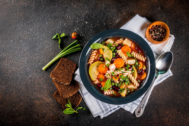 Italian vegetable soup minestrone with fusilli pasta
