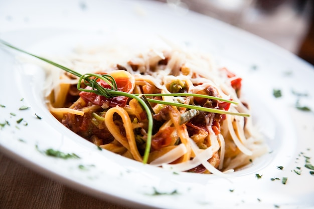 Italy, the best florence restaurant. example of fettuccine pasta served at the table, no studio photo