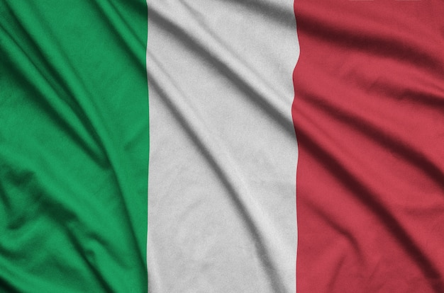 Italy flag is depicted on a sports cloth fabric with many folds.