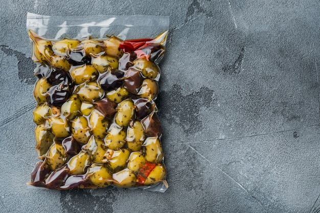 Italy fresh olives, on gray, top view