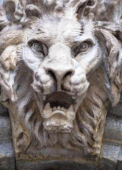 Italy, turin. made of stone and located on a marble arch, aroud 300 years old. fallen angel in the shape of a roaring lion.