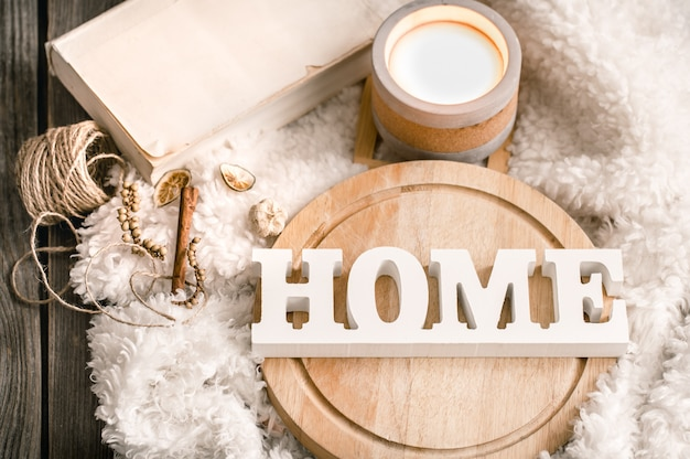 Items of cozy home decor with wooden letters