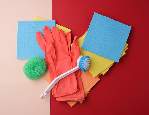 Items for home cleaning. gloves, brush and sponges for dusting