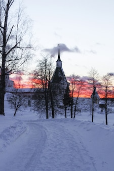Iversky monastery in valdai in the winter at sunset, russia