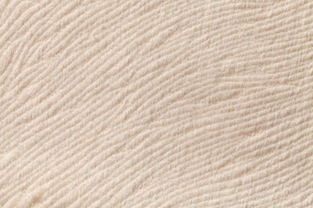 柔らかい繊維素材のアイボリーの背景。自然な風合いの生地。