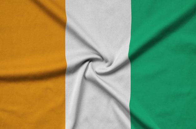 Ivory coast flag with many folds.