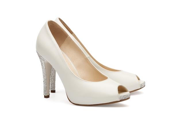 Ivory female wedding footwear isolated on white