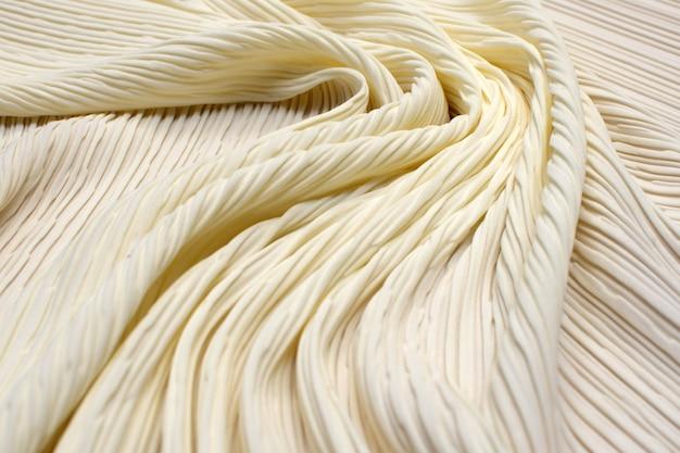 Плиссированная полиамидная ткань. ivory. текстура,