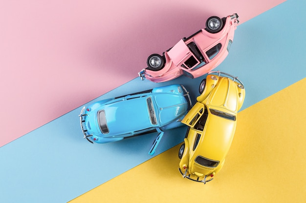 Izhevsk, russia, february 15, 2020. toy cars in accident on a pastel colorful background.