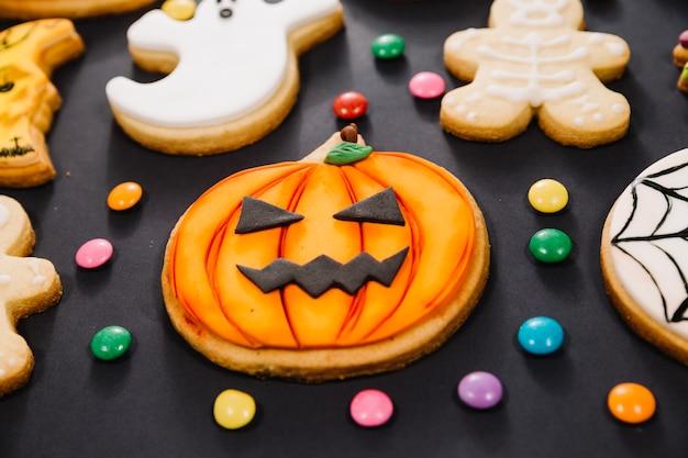 Jack-o-lantern cookie among treats