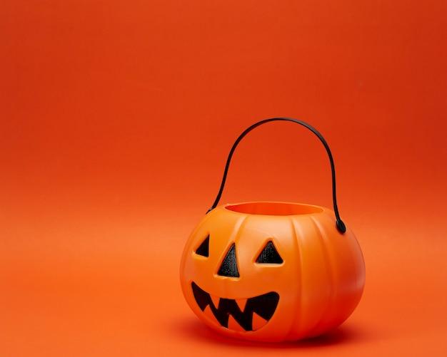 Jack o lantern pumpkin on an orange background