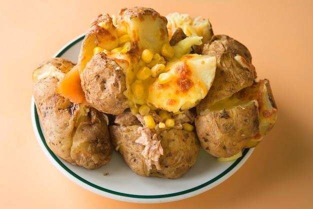 Jacket potato of tuna, mayonnaise and corn