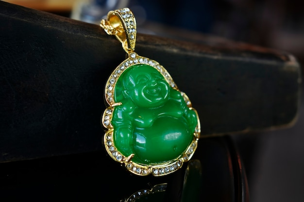 Jade is a gold pendant necklace