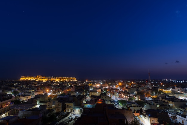 Jaisalmer cityscape at dusk. the majestic fort dominating the city. scenic travel destination and famous tourist attraction in the thar desert, rajasthan, india.