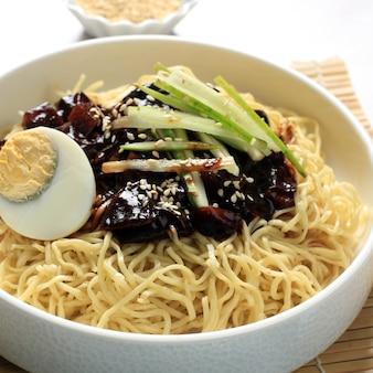Jajangmyeon or jjajangmyeon  is korean noddle with black sauce, square picture, close up