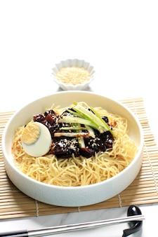 Jajangmyeon or jjajangmyeon  is korean noddle with black sauce, vertical picture, close up