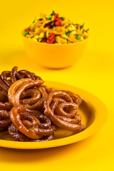 Jalebi and traditional indian deep fried salty dish called chivda or mixture or farsan