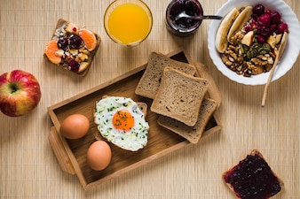 Jam and salad near breakfast food