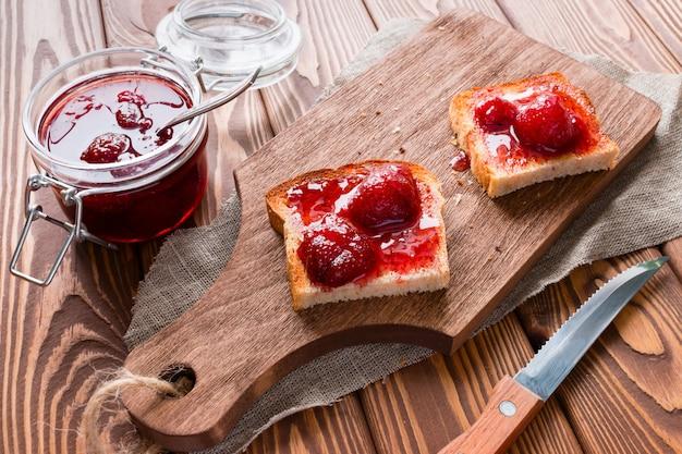 Jam sandwich on a cutting board