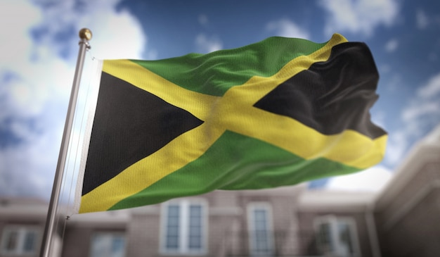 Jamaica flag 3d rendering on blue sky building background