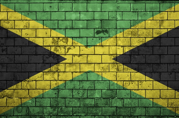Jamaica flag is painted onto an old brick wall