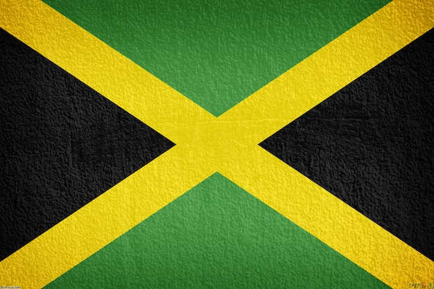 Jamaica flag on the old wall texture