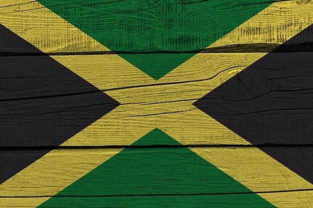 Jamaica flag painted on old wood plank