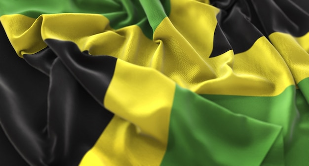 Jamaica flag ruffled beautifully waving macro close-up shot