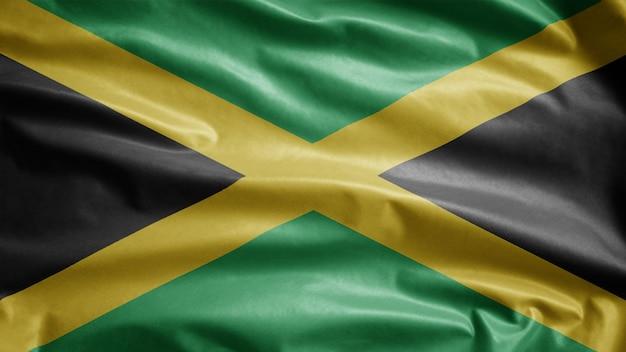 風に揺れるジャマイカの国旗。ジャマイカのバナーが吹く、柔らかく滑らかなシルク。