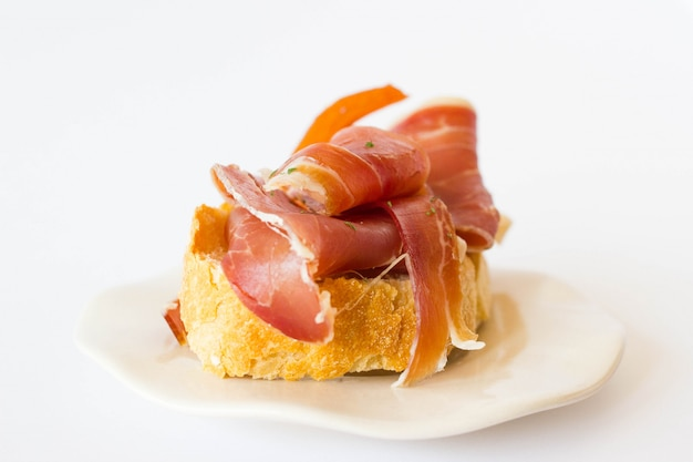 Jamon tapas side view. delicious curated ham typical from spain.