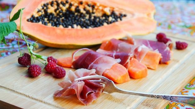 Jamon with papaya and raspberries
