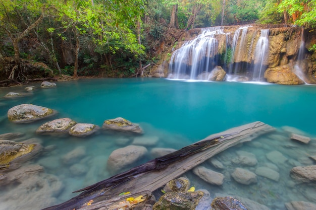 Jangle landscape with flowing turquoise water of erawan cascade waterfall at deep tropical rain forest