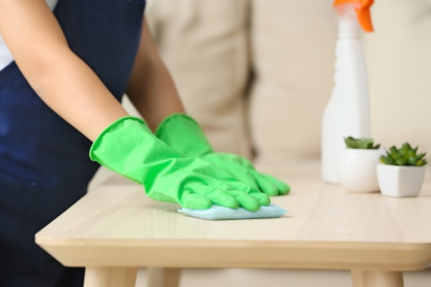 Janitor cleaning table in apartment