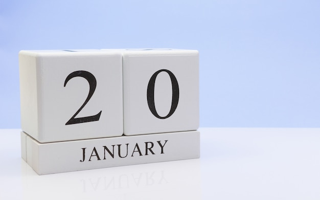 January 20st. day 20 of month, daily calendar on white table with reflection