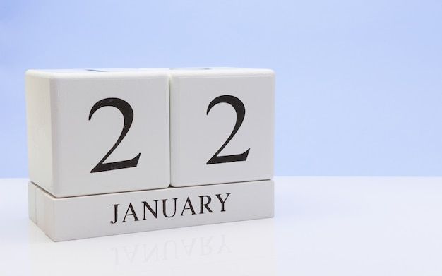 January 22st. day 22 of month, daily calendar on white table with reflection