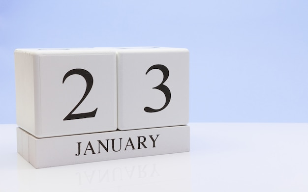 January 23st. day 23 of month, daily calendar on white table with reflection