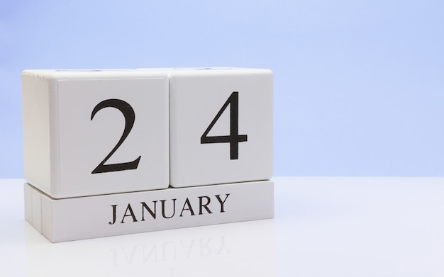 January 24st. day 24 of month, daily calendar on white table with reflection