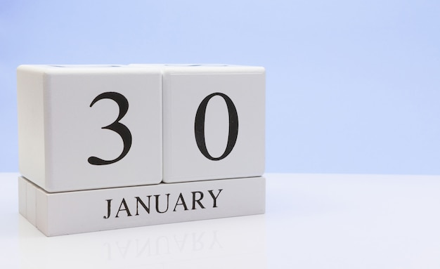 January 30st. day 30 of month, daily calendar on white table with reflection