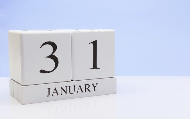 January 31st. day 31 of month, daily calendar on white table with reflection