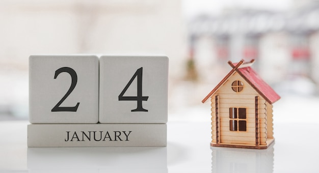 January calendar and toy home. day 24 of month. card message for print or remember