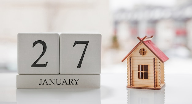 January calendar and toy home. day 27 of month. card message for print or remember