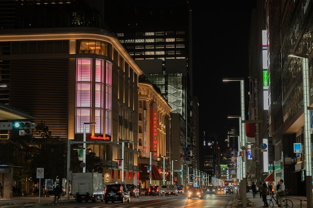 Japan city at night with cars and people