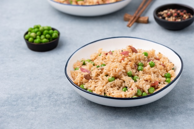 Japan fired rice with peas and chopstick