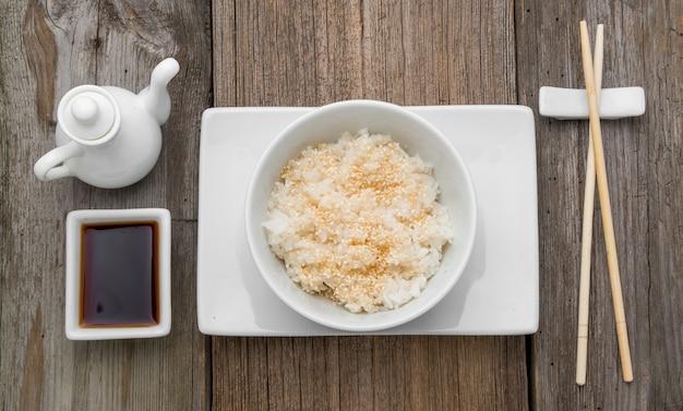 Japan rice and black sesame seeds with chopsticks