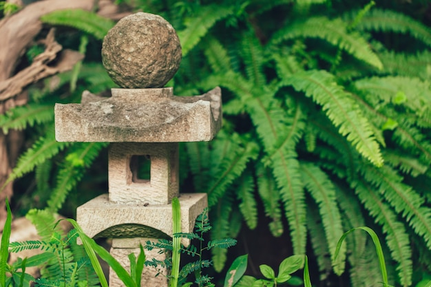 Japan style stone lantern lamp in japanese garden